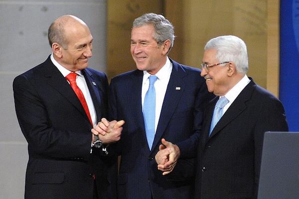 Prime Minister Ehud Olmert, President George W. Bush, and President Mahmoud Abbas at Annapolis, November 27, 2007 (Photo: Gin Kai)