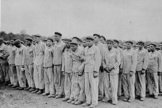 Prisoners standing during a roll call. Each wears a striped hat and uniform bearing colored, triangular badges and identification numbers. *''Buchenwald, [Thuringia] Germany, 1938-1941. [http://www.ushmm.org/ United States Holocaust Memorial Museum]