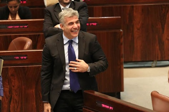 Finance Minister Yair Lapid in the Knesset, July 29, 2013 (Photo: Tali Mayer/ Activestills.org)