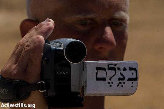 A Palestinian B'Tselem volunteer documenting a protest in the south Hebron Hills, June 14, 2008. (Oren Ziv/Activestills)