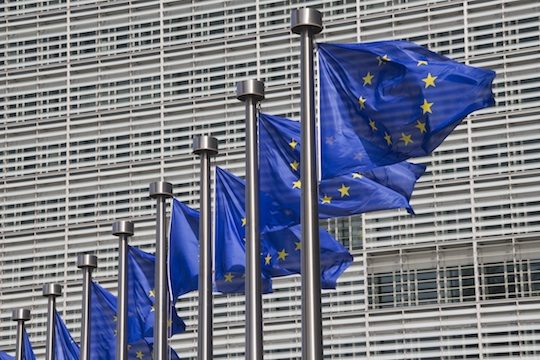 European Union flags outside the European Commission building in Brussels. (Shutterstock.com)