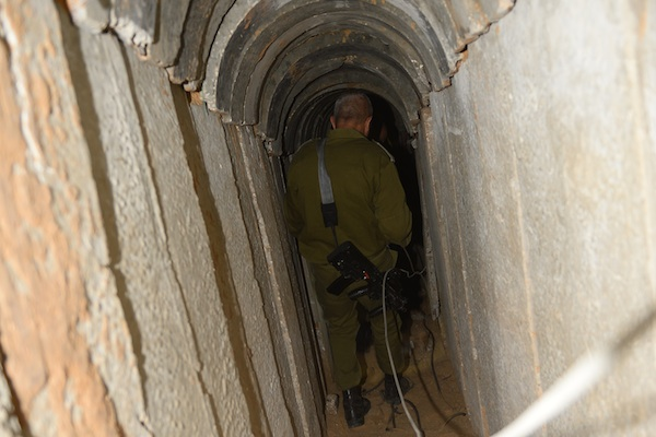 An IDF soldier walks through the tunnel the IDF uncovered underneath the Gaza-Israel border earlier this week. (Photo: IDF Spokesperson)