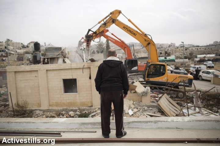 The home of the Palestinian Adgluni family is demolished by Israeli authorities, East Jerusalem, January 27, 2014. Israeli authorities claimed the house was built on lands that do not belong to the family. (photo: Tali Mayer/Activestills.org)