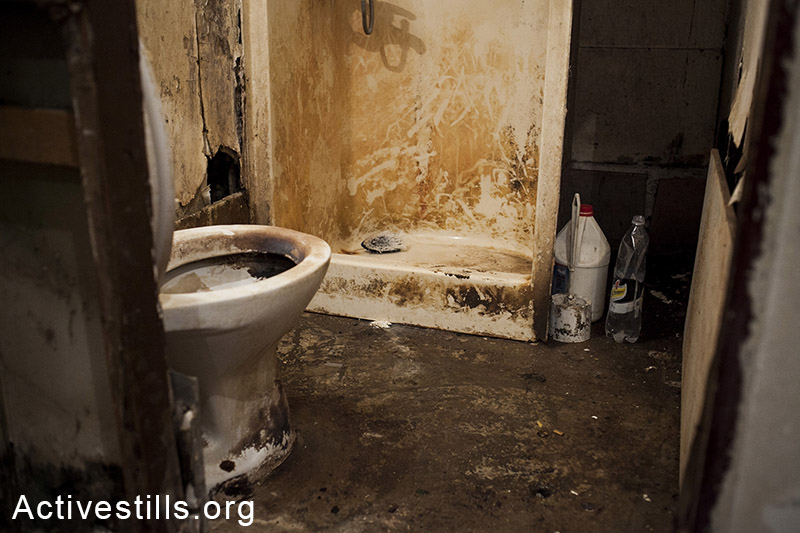 A view on the toilette and shower in the caravan, Moshav Yavetz, January 25.1.2014. (Shiraz Grinbaum/Activestills.org)