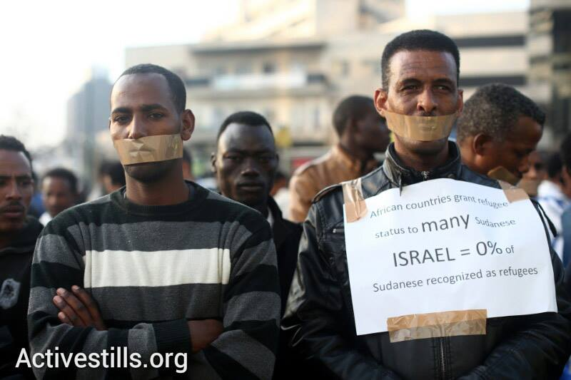 African asylum seekers participate in a silent demonstration in front of the African Union office in Tel Aviv, calling for international support in their struggle for recognition as refugees, January 22, 2014. (photo: Oren Ziv, Yotam Ronen/Activestills.org)