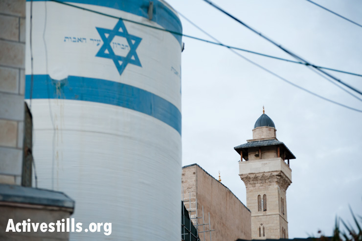 An Israeli settlement water tank stands near the Ibrahimi Mosque or Tomb of the Patriarchs in the West Bank city of Hebron. All settlements in the occupied Palestinian territories are illegal under international law.