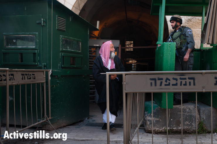 An elderly Palestinian man passes through an Israeli checkpoint in the center of Hebron's old city.