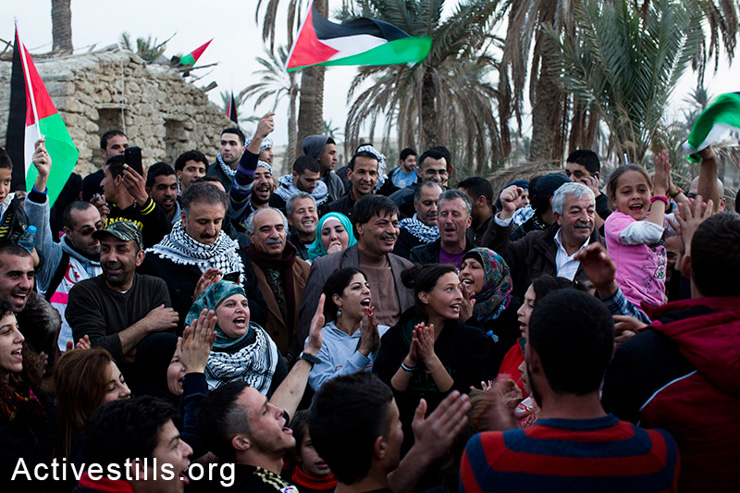 Palestinians shout slogans in the in Ein Hijleh protest village, in the Jordan Valley, West Bank January 31, 2014. Over 300 Palestinians participated in the action, as part of Melh Al-Ard (Salt of the Earth) campaign against the Israeli plan to annex the Jordan valley, discussed during the current round of negotiation-talks between the PA and Israel, coordinated by John Kerry. (photo: Keren Manor/Activestills.org)