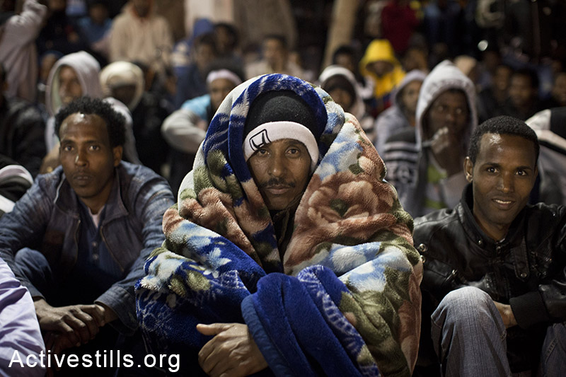 African asylum seekers staging a sit-in at Levinsky park in Tel Aviv, protesting against the new detention center, calling to the Israeli government to recognize their refugee rights, February 2, 2014. (Activestills.org)