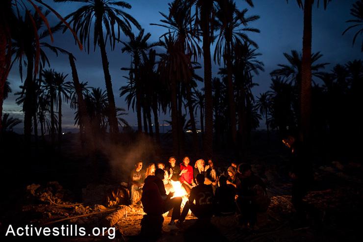 Palestinians sit around a fire in the Ein Hijleh protest village in the Jordan Valley, West Bank January 31, 2014. (photo: Oren Ziv/Activestills.org)