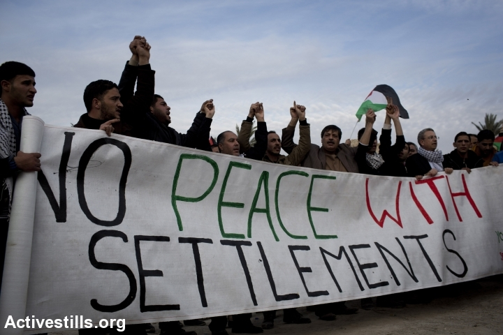 Palestinian activists shout slogans upon arrival to Ein Hijleh protest village, in the Jordan Valley, West Bank January 31, 2014.