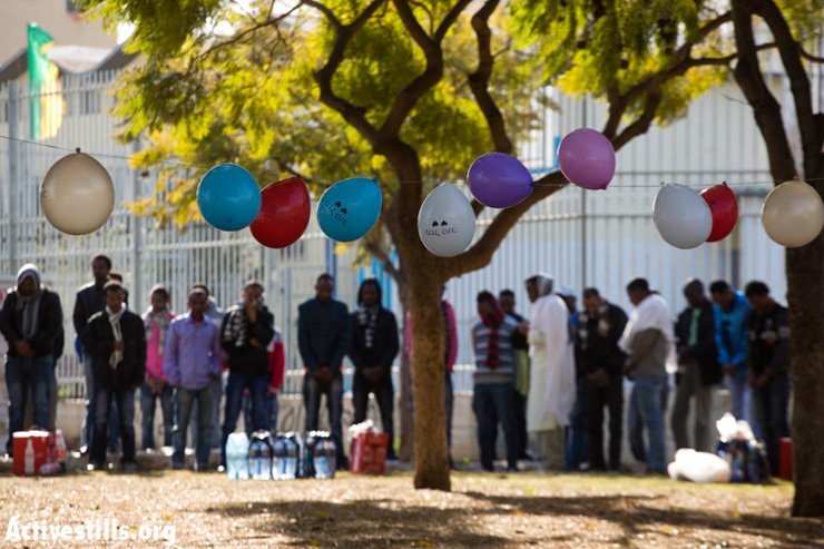 Eritreans mourn next to balloons hung by right-wing protesters