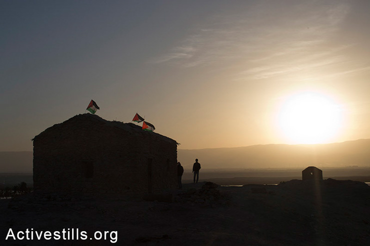 Palestinian activists greet the rising sun in Ein Hijleh protest village, in the Jordan Valley, West Bank, February 1, 2014. (photo: Oren Ziv/Activestills.org)