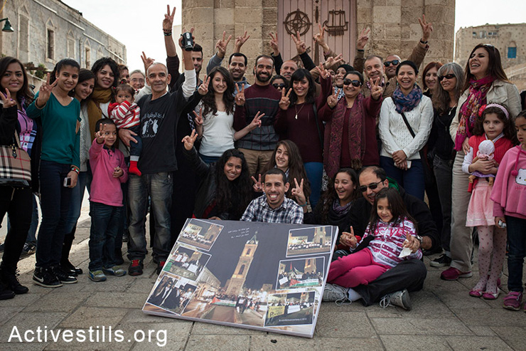 Former hunger striker Samer Issawi is greeted by activists in Jaffa's clock square, February 1, 2014. Samer Issawi was on hunger strike in the Israeli prison for more than 200 days, protesting his prolonged administrative detention. Jaffa activists staged daily protests in the months prior to his release. (photo: Shiraz Grinbaum/Activestills.org)