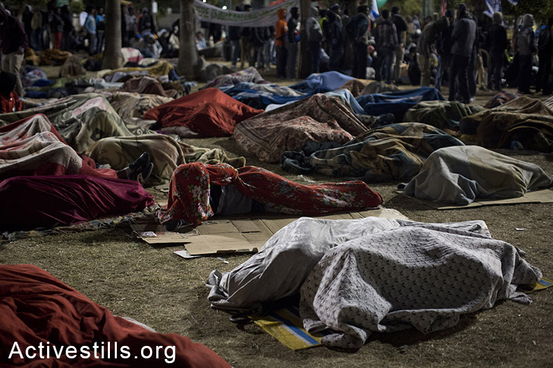 African asylum seekers sleep on the first night of a sit-in at Levinsky park in Tel Aviv, protesting against the new detention center, calling to the Israeli government to recognize their refugee rights, February 2, 2014. (Activestills.org)