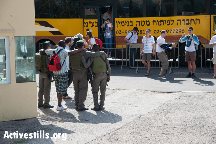 Tourists take photos with Israeli soldiers in Hebron, West Bank, November 1, 2012.