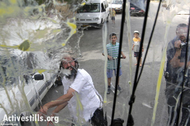 Israeli settlers attack a Palestinian home in Hebron, April 25, 2008.