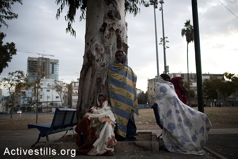 African asylum seekers wake up on the second day of a sit-in at Levinsky park in Tel Aviv, protesting against the new detention center, calling to the Israeli government to recognize their refugee rights, February 3, 2014. (Activestills.org)