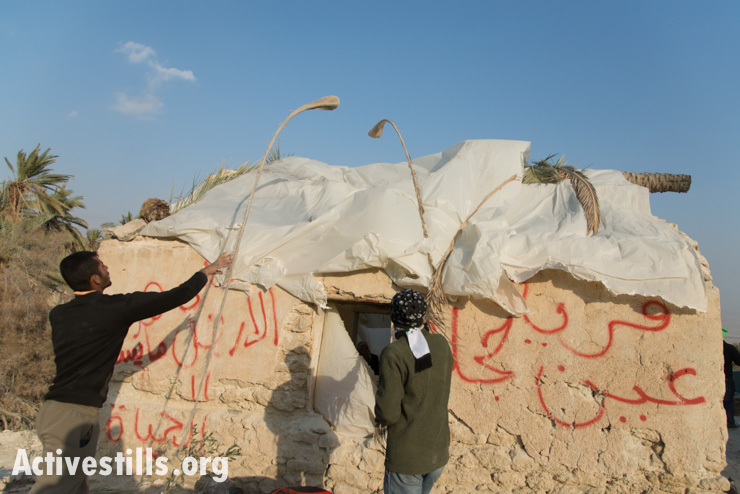 Palestinians use palm branches to keep plastic sheeting in place during high winds in the protest village of Ein Hijleh, Jordan Valley, West Bank, February 3, 2014. (photo: Activestills.org)