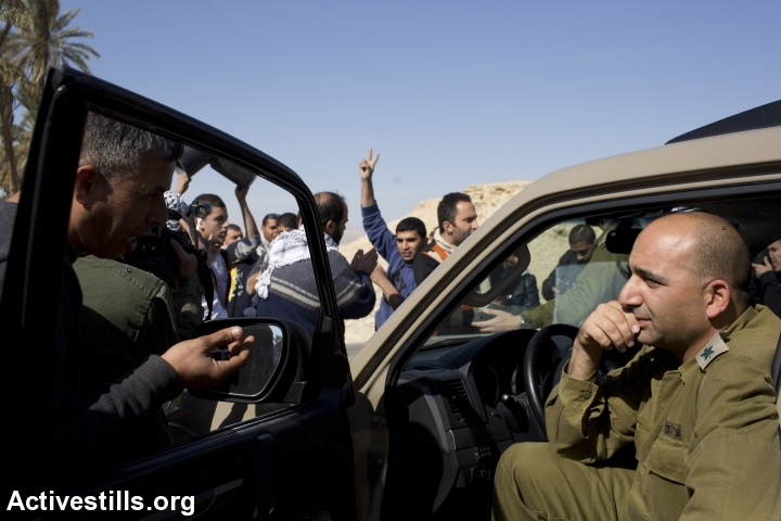 Palestinian activists argue with Israeli soldiers in the Ein Hijleh protest village, in the Jordan Valley, West Bank, January 31, 2014. Army issued a 'closed military zone' warrant to the activists.