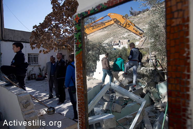 The Mezri family made the decision to demolish their own home after they learned they would be forced to pay for the demolition by the Israeli authorities, Jabal Mukaber, East Jerusalem, February 5, 2014. (photo: Tali Mayer/Activestills.org)