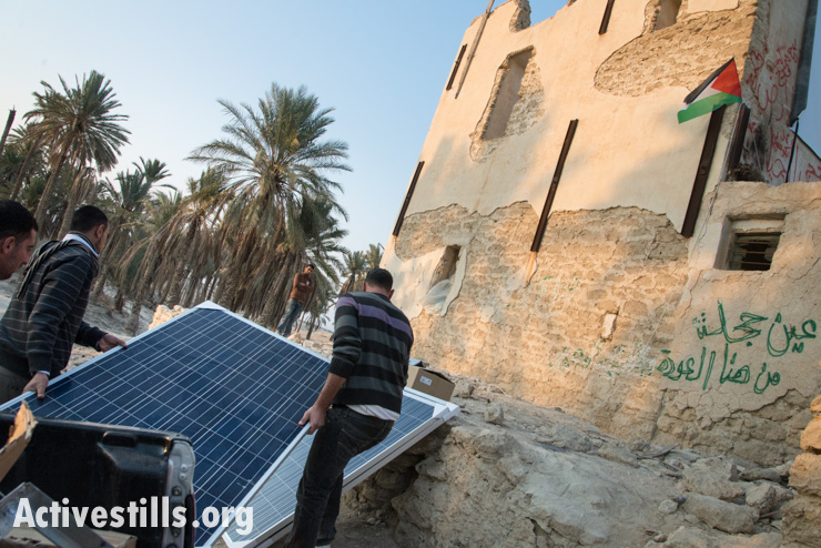 Palestinians deliver solar panels to the Jordan Valley protest village of Ein Hijleh, West Bank, February 6, 2014. The panels were donated by the Applied Research Institute, Jerusalem (ARIJ) a Palestinian NGO. (photo: Activestills.org)