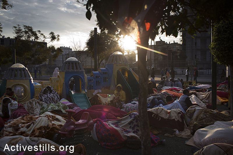 African asylum seekers wake up on the third day of a sit-in at Levinsky park in Tel Aviv, protesting against the new detention center, calling to the Israeli government to recognize their refugee rights, February 4, 2014. (Activestills.org)