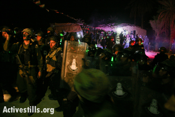 Israeli army and police raid and evict the Ein Hijleh protest camp in the early morning hours of February 7, 2014. (photo: Activestills.org)