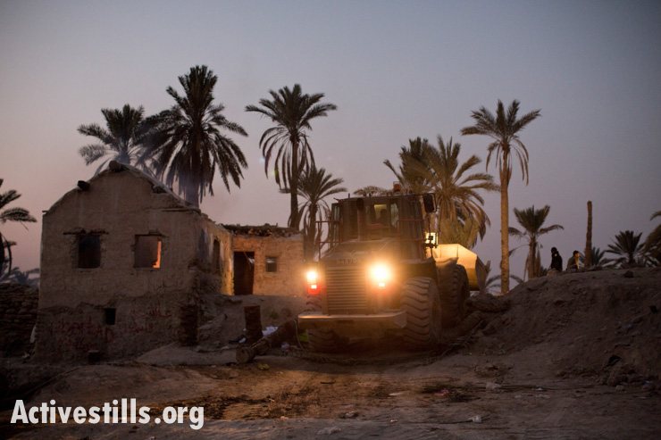 Israeli army bulldozers clear an area in the Ein Hijleh protest village after the Israeli soldiers and police evicted the village, located in the Jordan Valley, West Bank, in the early hours of February 7, 2014. (photo: Activestills.org)