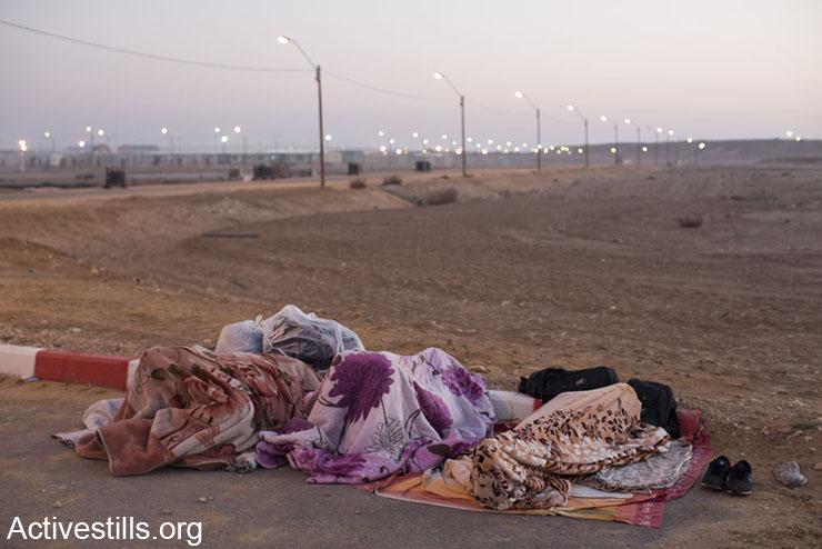 African asylum seekers sleep in the early morning of a second day of protest outside the Holot detention center where hundreds of Aylum seekers are jailed, February 18, 2014 in the southern Negev desert of Israel
