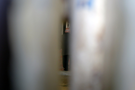 Female worshippers press themselves against the metal door. This is what it looks like from the Jewish side. (Photo by Einat Fishbain)