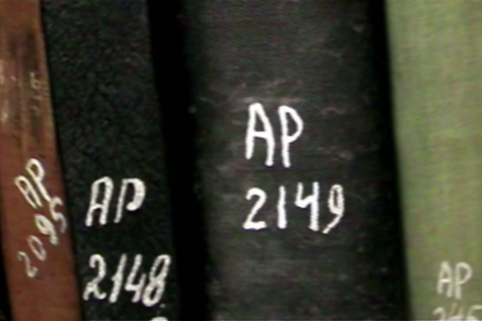 """""""Palestinian-owned books at Israel's National Library, marked 'AP' for 'abandoned property. (Screenshot from 'The Great Book Robbery')"""