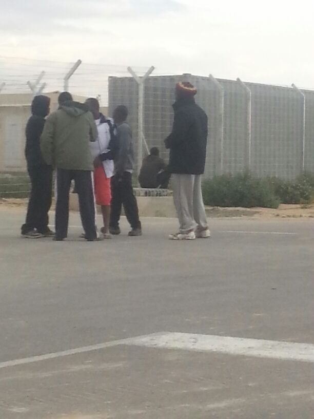 Some friends near the gate, awaiting new comers, March 12, 2014. (Ahmad)