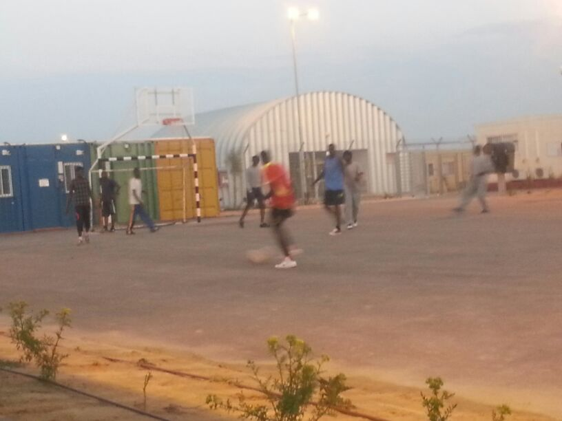 Some friends playing soccer near the gate, at guards await new-comers, March 12, 2014. (Ahmad)