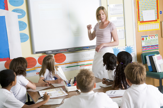 Illustrative photo of school children and a teacher in class (Photo by Shutterstock.com)