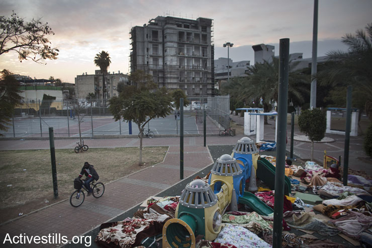 African asylum seekers sleep in Levinsky Park, south Tel Aviv, on the fifth day of an ongoing protest, February 6, 2013. The sit-in protested the new Holot detention center for African immigrants and called on the Israeli government to recognize their refugee rights. (photo: Oren Ziv/Activestills.org)