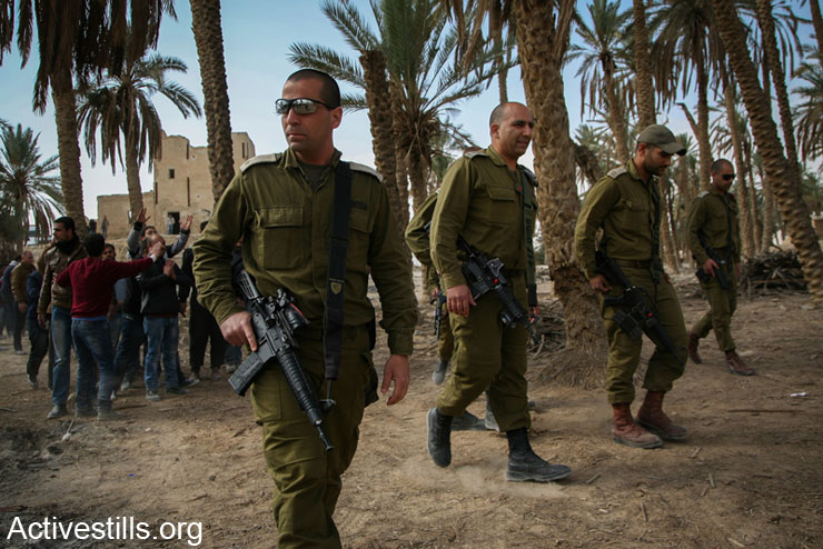 Israeli soldiers patrol in the the Ein Hijleh protest camp, Jordan Valley, West Bank, February 5, 2014. (photo: Hamde Abu Rahma/Activestills.org)