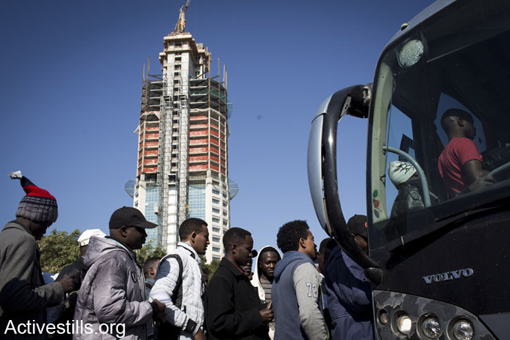 African Asylum seekers board a bus of the Israeli immigration authority before leaving for Holot detention center, Tel Aviv, Israel, February 9 , 2014. The Israeli immigration authority summoned a few dozens asylum seekers, ordering them to arrive at Holot detention center. Around 50 complied. According to human rights organizations, over 1,700 African asylum seekers received similar summons scheduled for the coming weeks, informing them their current visa is cancelled. (photo: Tali Mayer/Activestills.org)