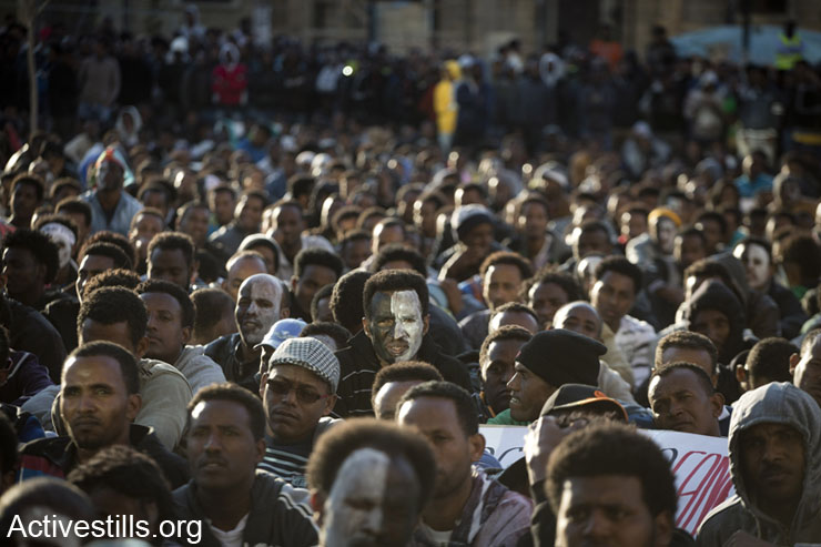 African asylum seekers shout slogans during a protest in front of Israel Ministry of Interior offices in Tel Aviv, February 11, 2014. (photo: Oren Ziv/Activestills.org)