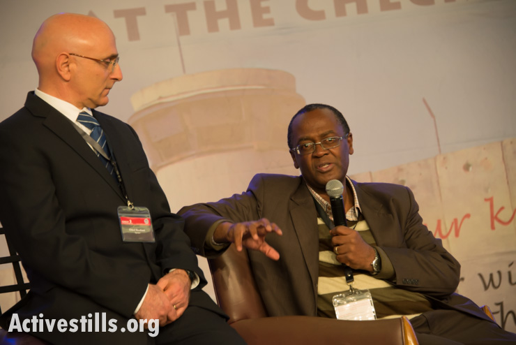 Oded Shoshani, pastor of the Hebrew congregation of King of Kings in Jerusalem, listens as Moss Ntha, General Secretary of the Evangelical Alliance of South Africa, speaks at the Christ at the Checkpoint conference in the West Bank town of Bethlehem, March 13, 2014. (photo: Ryan Rodrick Beiler/Activestills.org)