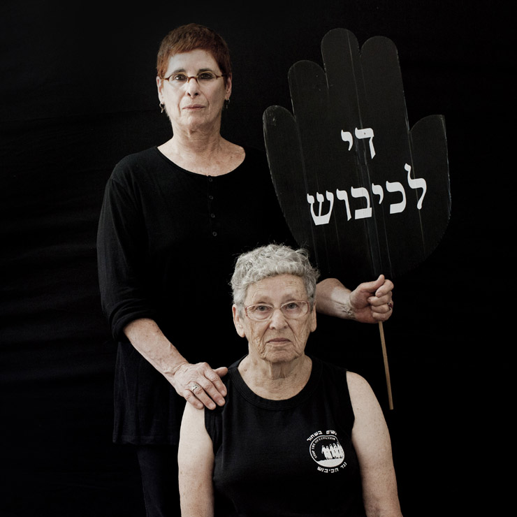Dafna Kaminer (sitting), co-founder of Women In Black and Tamar Leahn, 71, active for 20 years in Women In Black, Jerusalem group.