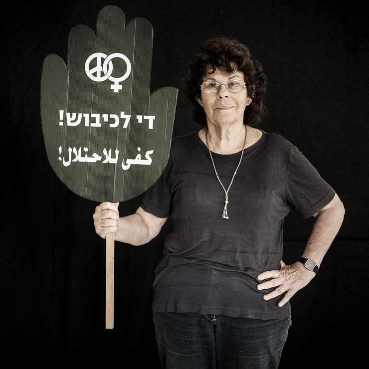 Edna Zaretzki Toledano, 72, co-founder of Women In Black, Haifa Group, holds a sign that reads 'stop the occupation' in both Hebrew and Arabic.
