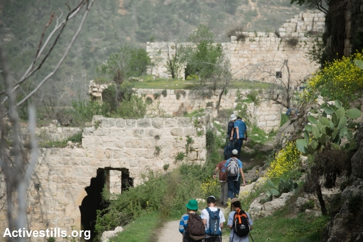 A group of Jewish boys visit the depopulated Palestinian village of Lifta, located on the edge of West Jerusalem, Israel, March 4, 2014. During the Nakba, the residents of Lifta fled attacks by Zionist militias beginning in December 1947, resulting in the complete evacuation of the village by February 1948. (Photo by Ryan Rodrick Beiler/Activestills.org)