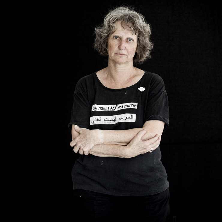"Varda Sivan, 62, active for 20 years in Women In Black, Haifa group, wears a shirt with the slogan ""War is not my language"" in Hebrew and Arabic."