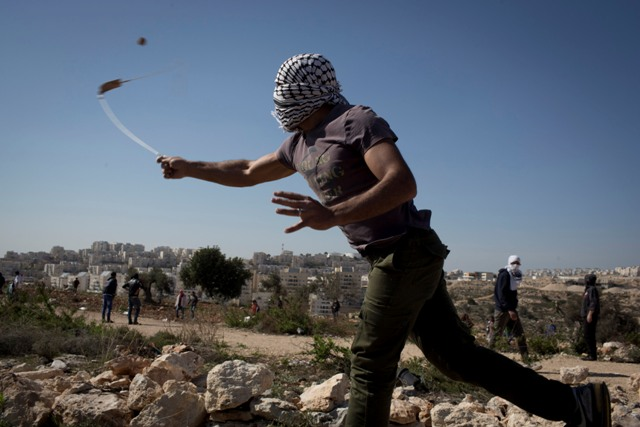 Soldiers shot tear gas and rubber bullets, while local youths responded with stones. (Oren Ziv / Activestills)