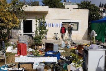 Israeli settlers move into the home of an evicted Palestinian family in Sheikh Jarrah (Photo by Activestills.org)
