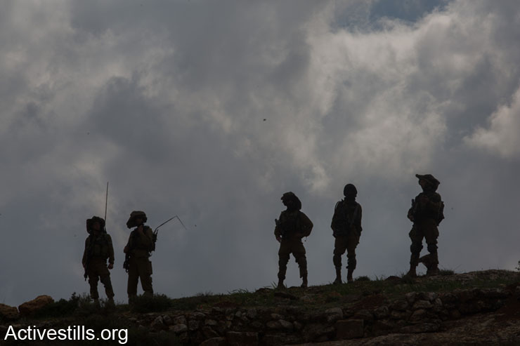 Israeli soldiers seen during clashes following the funeral of Saji Sayel Darwish, who was shot by Israeli soldier on a road to Ramallah on March 11, 2014 Beitin, West Bank. (photo: Activestills.org)