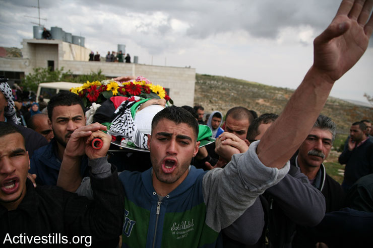 Palestinians carry the body of  Saji Darwish during his funeral of   in the West Bank village of Beitin, March 11, 2014. Darwish, a 18 year old media student at Birzeit University, was shot by an Israeli sniper in front of his house. Thousands came to mourn, calling on the Palestinian Authority to end peace talks with Israel.In the last 24 hours, six Palestinians have been killed by Israeli forces; 3 by airstrikes in Gaza and 3 in the West Bank who were killed individually. The incidents in the West Bank took place in Beitin, Tulqarem and at the Allenby bridge. The number of Palestinians killed by Israeli forces since the start of the recent peace talks now stands at 44.