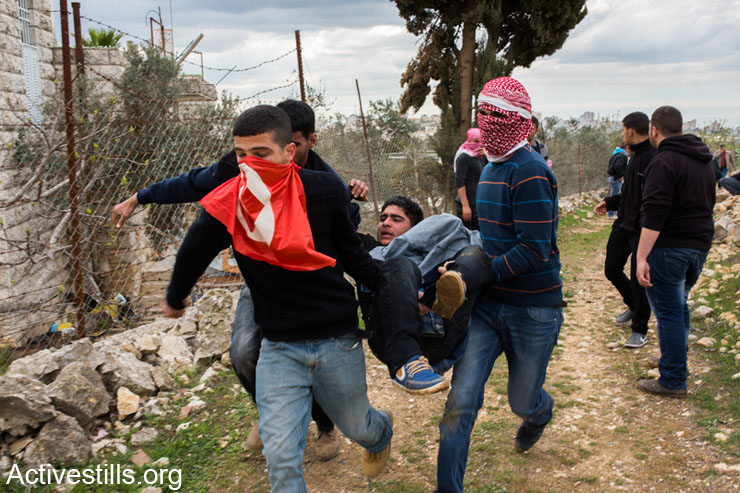 Clashes following the funeral of Saji Sayel Darwish who was shot Monday night by Israeli soldier on a road to Ramallah on March 11, 2014, West Bank. (photo: Activestills.org)