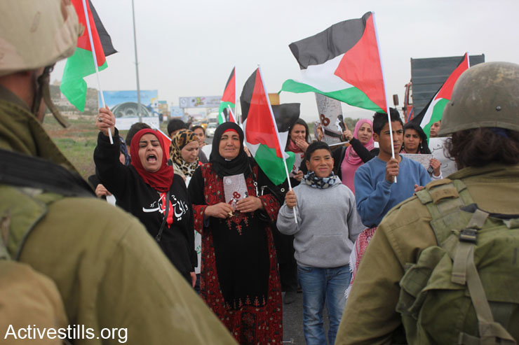 Palestinian women demonstrate against Israeli occupation at Huwwara military checkpoint on the International Women's Day, Nablus, West Bank, March 8th, 2014.